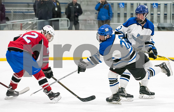 03/01/18 Wesley Bunnell | Staff Hall-Southington defeated EO Smith-Tolland 4-3 in the CCC South semi-final game on Thursday at Veterans Memorial Rink in West Hartford. Jacob Albert (22).