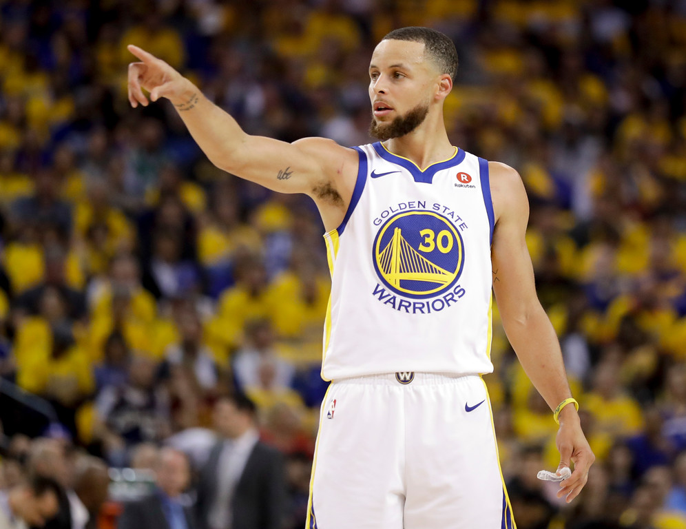 . Golden State Warriors guard Stephen Curry (30) gestures during the first half of Game 1 of basketball\'s NBA Finals between the Warriors and the Cleveland Cavaliers in Oakland, Calif., Thursday, May 31, 2018. (AP Photo/Marcio Jose Sanchez)