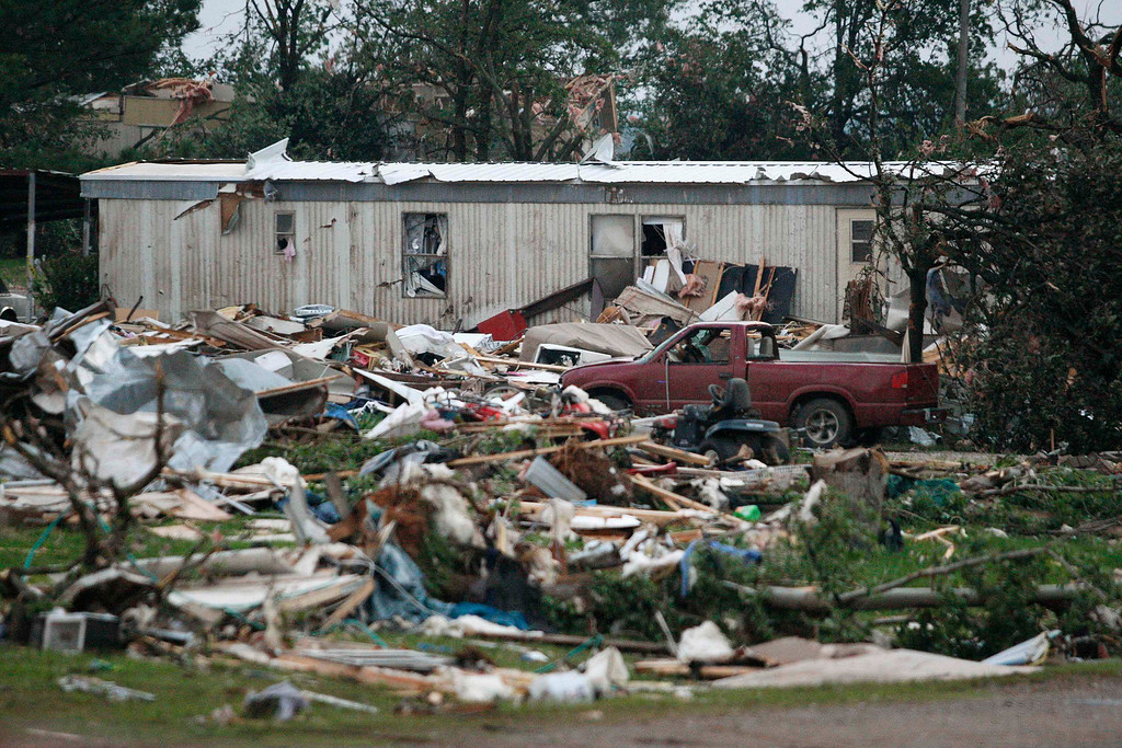 . Debris is seen at a mobile home park which was destroyed by a tornado on Sunday, west of Shawnee, Oklahoma May 19, 2013. A tornado half a mile wide struck near Oklahoma City on Sunday, part of a massive storm front that hammered the central United States. News reports said at least one person had died. REUTERS/Bill Waugh