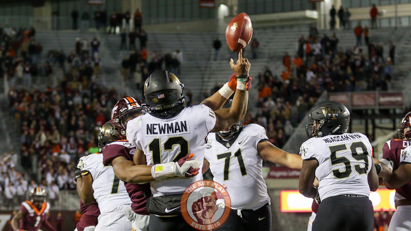 Wake Forest QB Jamie Newman is hit as he throws by Tyjuan Garbutt, causing an interception. (Mark Umansky/TheKeyPlay.com)