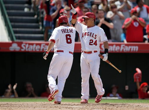 . Los Angeles Angels\' David Freese, left, celebrates his home run with Hank Conger during the eighth inning of a baseball game against the Detroit Tigers on Sunday, July 27, 2014, in Anaheim, Calif. (AP Photo/Jae C. Hong)