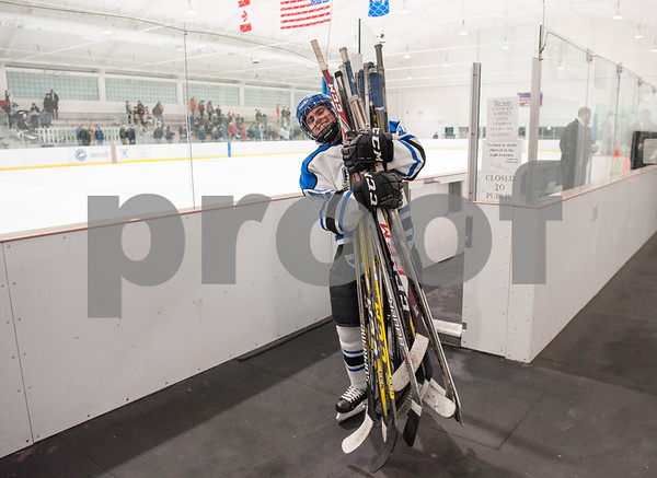 03/01/18 Wesley Bunnell   Staff Hall-Southington defeated EO Smith-Tolland 4-3 in the CCC South semi-final game on Thursday at Veterans Memorial Rink in West Hartford. Michael DiPietro (10) happily carries the sticks for the bench into the locker room after the win.