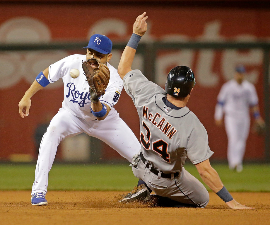 . Detroit Tigers\' James McCann (34) beats the tag by Kansas City Royals second baseman Omar Infante to steal second during the fourth inning of a baseball game Friday, Sept. 19, 2014, in Kansas City, Mo. (AP Photo/Charlie Riedel)