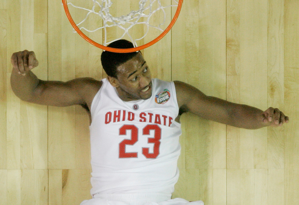 . Ohio State\'s David Lighty (23) reacts while lying on the floor after scoring in the second half of a 67-60 win over Georgetown during their NCAA Final Four game at the Georgia Dome in Atlanta Saturday, March 31, 2007. (AP Photo/John Bazemore)
