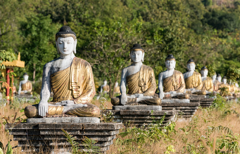 Row of Buddha statues in Lumbini Garden under Mt Zwegabin, Hpa-an, Karen (Kayin) State, Burma