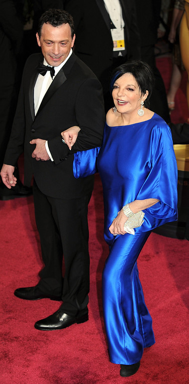 . Liza Minnelli and guest attend the 86th Academy Awards at the Dolby Theatre in Hollywood, California on Sunday March 2, 2014 (Photo by John McCoy / Los Angeles Daily News)