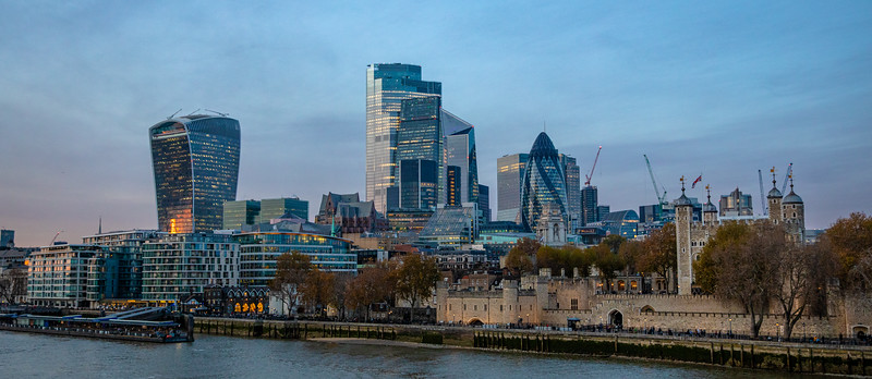 "Tower of London in the lower right, with a portion of the modern cityscape behind it. The curved tall building on the left is nicknamed ""the walkie-talkie."""