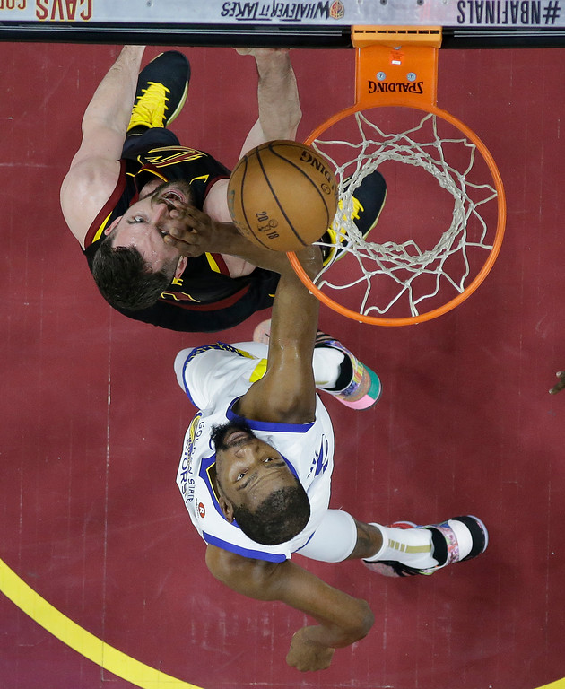 . Golden State Warriors\' Kevin Durant, bottom, and Cleveland Cavaliers\' Kevin Love eye a rebound during the first half of Game 3 of basketball\'s NBA Finals, Wednesday, June 6, 2018, in Cleveland. (AP Photo/Carlos Osorio, Pool)