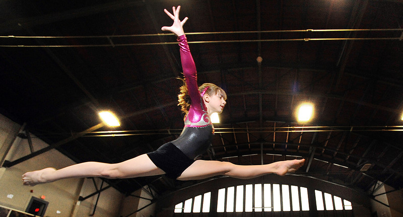 Lauren Theriault, 10, of Lewiston, practices her floor routine at the Lewiston Armory Tuesday afternoon with the Lewiston Recreation Department Gymnastics team.  The team is part of the Auburn-Lewiston YMCA League.
