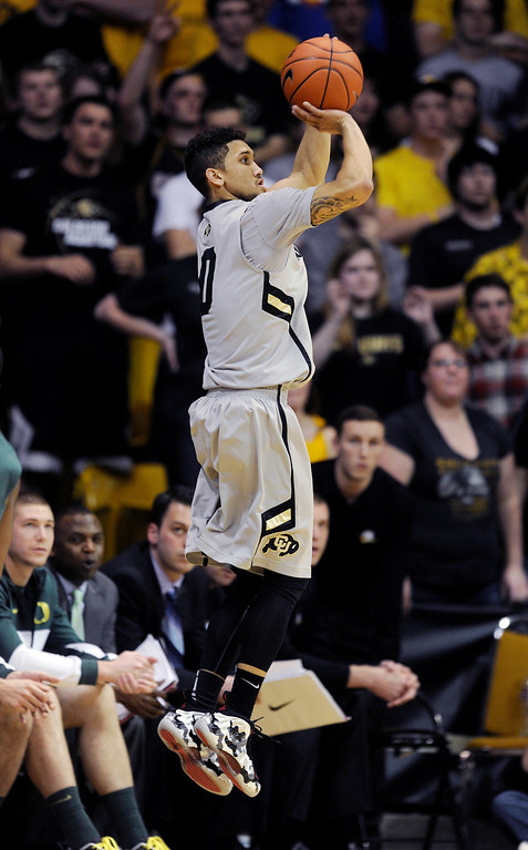 . BOULDER, CO. - MARCH 7: Colorado point guard Askia Booker (0) shot from long range in the first half. The University of Colorado men\'s basketball team hosted Oregon Thursday night, March 7, 2013 at the CU Events Center in Boulder. (Photo By Karl Gehring/The Denver Post)