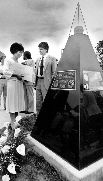 . Lorna Onizuka (left), widow of astronaut Ellison Onizuka, and Colorado University faculty member Dr. Thomas Ayres view a pyramid-shaped memorial representing the sun, following dedication ceremonies Tuesday afternoon, May 1, 1987. The Colorado Scale Model Solar System is dedicated in memory of Ellison Onizuka, a University of Colorado alumnus, and his six crew mates of the space shuttle Challenger. The memorial is located on the C.U. campus.  Mike Lang, Denver Post Library Archive
