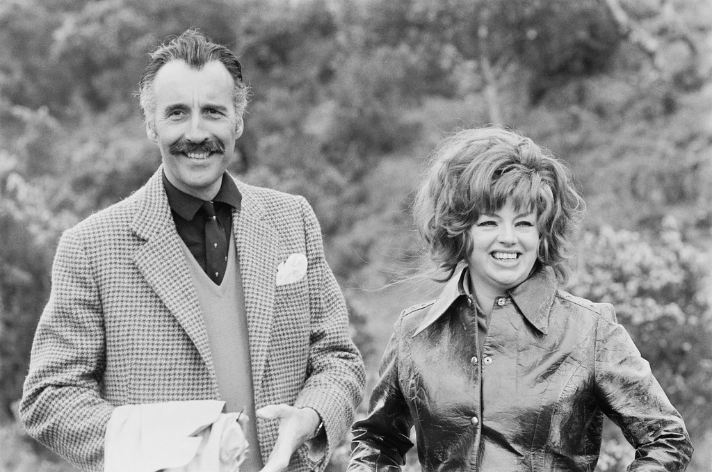 . English actors Christopher Lee and Diana Dors (1931 - 1984) on the film set for \'Nothing But the Night\', Dartmoor, Devon, 5th May 1972. (Photo by Jack Kay/Daily Express/Hulton Archive/Getty Images)