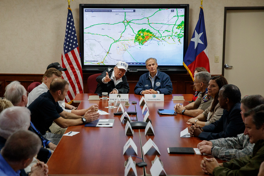 . President Donald Trump, accompanied by Texas Gov. Greg Abbott, speaks at the the Texas Department of Public Safety Emergency Operations Center, Tuesday, Aug. 29, 2017, in Austin, Texas. (AP Photo/Evan Vucci)