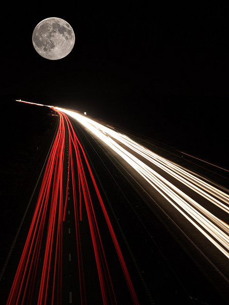 As featured on BBC's 'Stargazing Live' on Jan 3rd 2011.  January 2005 captured with Olympus E1 on the A14 Leics/Northants border. Head and tail lights, full moon added in PS.