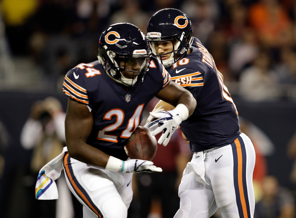 . Chicago Bears quarterback Mitchell Trubisky (10) hands off the ball to running back Jordan Howard (24) during the first half of an NFL football game against the Minnesota Vikings, Monday, Oct. 9, 2017, in Chicago. (AP Photo/Darron Cummings)