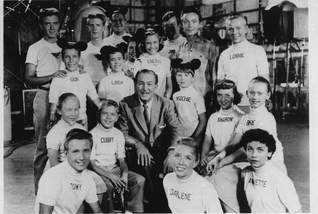 """. Cast members of the \""""Mickey Mouse Club\"""" surround cartoonist television empire founder Walt Disney in this undated photo released by Disney Television.  (AP Photo/ho)"""