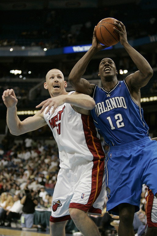 . TAMPA, FL - OCTOBER 15:  Dwight Howard #12 of the Orlando Magic attempts to shoot against Michael Doleac #12 and the Miami Heat during the preseason game on October 15, 2004 at the St. Petersburg Times Forum in Tampa, Florida. The Heat won 95-89.  (Photo by Eliot J. Schechter/Getty Images)