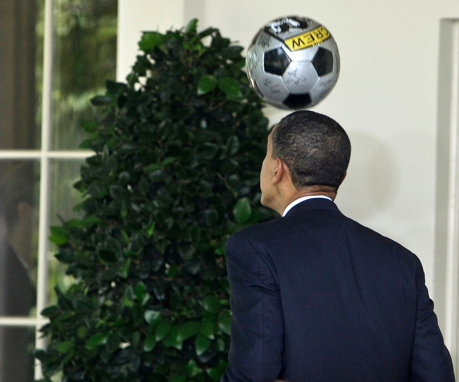 . President Barack Obama heads a soccer ball as he walks to The Oval Office after a ceremony with members of the Columbus Crew soccer team in the Rose Garden at The White House in Washington Monday, July 13, 2009.(AP Photo/Alex Brandon)