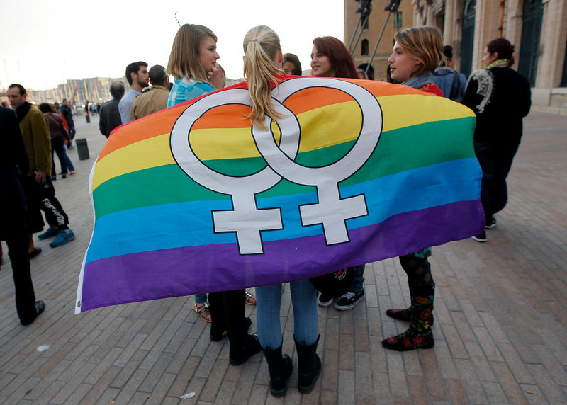 . People gather outside Marseille\'s town hall to attend a demonstration to support the passage of the same-sex marriage bill in Marseille, April 23, 2013. French parliament approved a law allowing same-sex couples to marry and to adopt children on Tuesday, a flagship reform pledge by French President which sparked often violent street protests and a rise in homophobic attacks. The law legalizes gay marriage and gives gay and lesbian couples adoption rights.  REUTERS/Jean-Paul Pelissier