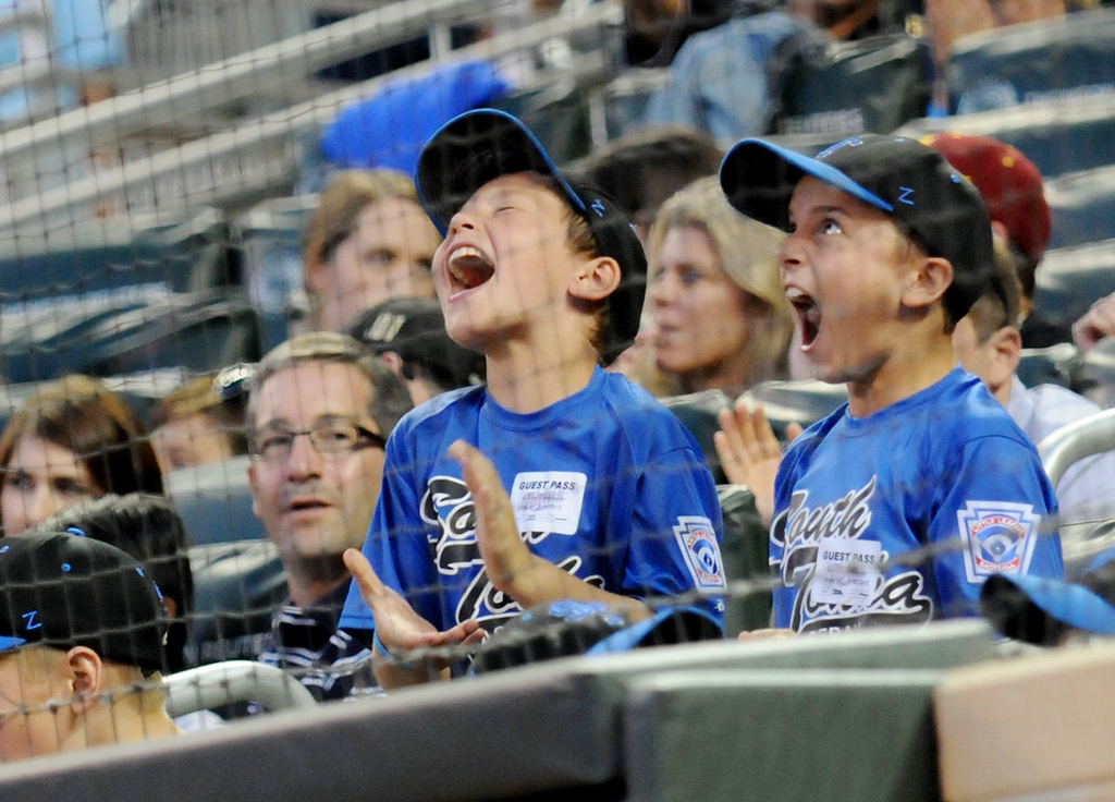 . Two young fans cheer as loud as they can as during a bases-loaded situation. (Pioneer Press: John Autey)