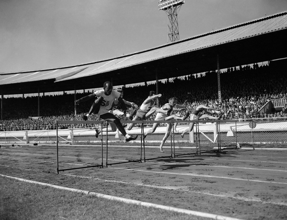 . Runners jump in the 120 Yard International Hurdles Race during the British Games, incorporating International Athletics Match, in White City, London on June 6, 1949. The competitors are P Van de Sype of Belgium (no.1); A. Marie of France (no.3); Donald Finlay of Great Britain (no.4); E. Arneberg of Norway (no.5); Harrison Dillard of the USA (No.6); and G. V. D. Hoeven of Holland (no.7). Dillard won the event in 14.4 seconds, followed by A. Marie in second place and Finlay in third. (AP Photo)