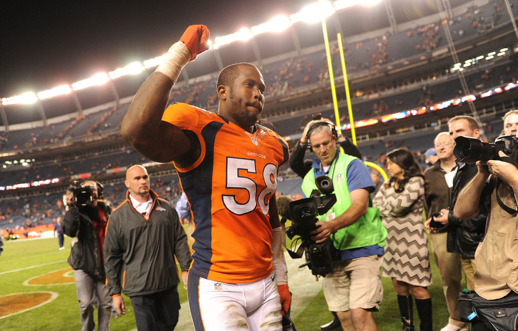 . Denver Broncos outside linebacker Von Miller #58 walks off after the Denver Broncos defeated the Tampa Bay Buccaneers 31-23 to clinch the AFC West Division. The Denver Broncos vs The Tampa Bay Buccaneers at Sports Authority Field Sunday December 2, 2012. Joe Amon, The Denver Post