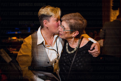 Louise Chernin (right), president and CEO of the Greater Seattle Business Association, gets a congratulatory hug from lise Lindborg of Zippy Dogsfor being honored with the Lifetime Achievement Award at the Puget Sound Business Journal's The Business Of Pride event at the Paramount Theatre in Seattle on Thursday, May 26, 2016. (BUSINESS JOURNAL PHOTO | Dan DeLong)