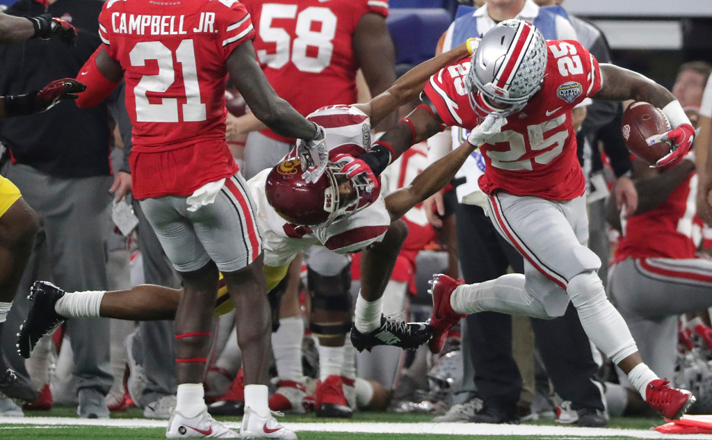 . Ohio State running back Mike Weber (25) tries to shake off Southern California cornerback Isaiah Langley during the first half of the Cotton Bowl NCAA college football game in Arlington, Texas, Friday, Dec. 29, 2017. (AP Photo/LM Otero)