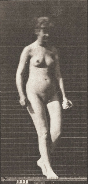 Nude woman walking and turning around