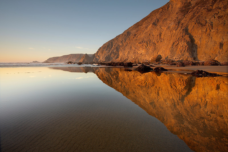 Kehoe Beach has numerous tide pools during a very low tide. And it also has some nice flat sand that is perfect for reflecting the  red cliffs at sunset.   I have been here many times even at low tide and not seen it like this.  And even on this day, it was only like  this for a few minutes.