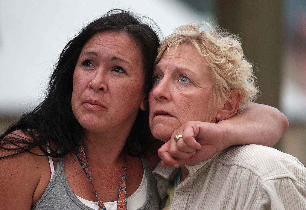 . Pine residents Kylie Rivera, left, and Gloria Koch watch the approaching flames from the 80,000 acres Elk Complex FIre in Pine, Idaho, on Sunday Aug. 11, 2013.  (AP Photo/Times-News, Ashley Smith)  Mandatory  Credit