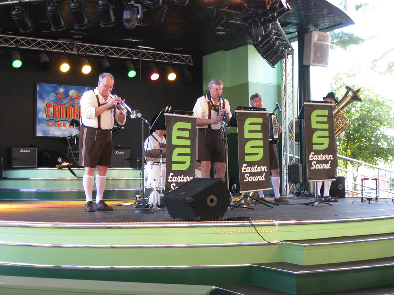 An Oktoberfest band playing on the Midway Stage.