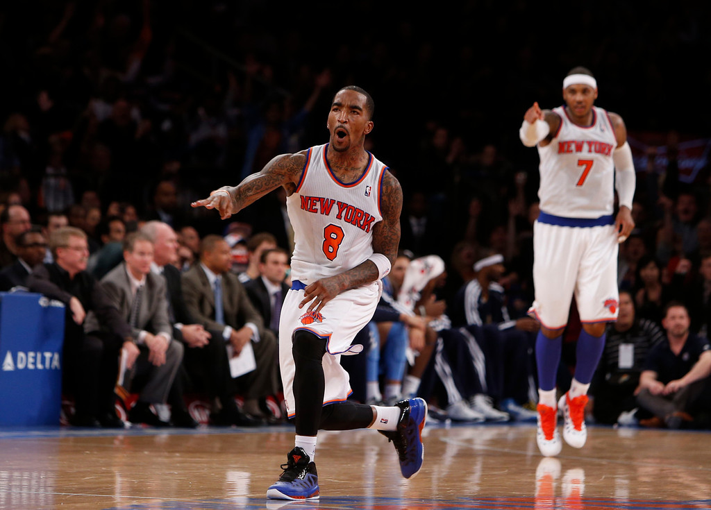. New York Knicks\' J.R. Smith (8) reacts after hitting a three-point shot against the Denver Nuggets during an NBA basketball game, Sunday, Dec. 9, 2012, in New York.  New York beat Denver, 112-106. (AP Photo/Jason DeCrow)
