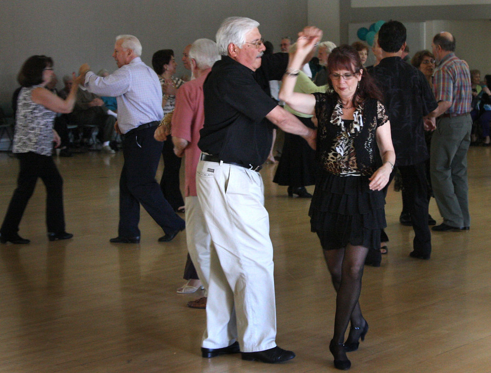 . Frank Portillo, left and Theresa Marshall dance to the music by the Cool Tones with lead singer, Kathy Blackburn,  at the Pleasanton Senior Center\'s 20th anniversary celebration tea dance in Pleasanton, Calif. on Sunday, March 3, 2013.  (Jim Stevens/Staff)