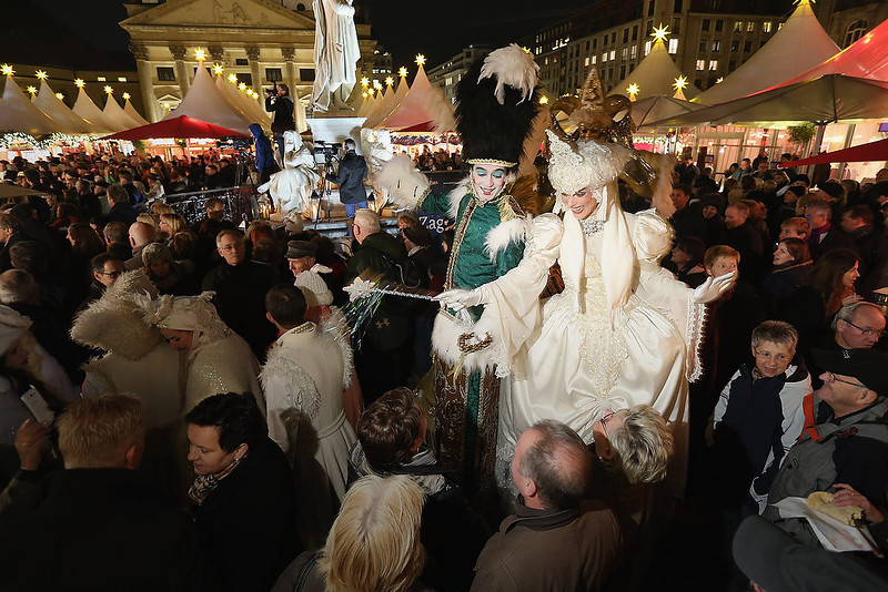 . Performers on stilts walk among visitors at the annual Christmas market at Gendarmenmarkt on its opening day on November 26, 2012 in Berlin, Germany. Christmas markets, with their stalls selling mulled wine, Christmas tree decorations and other delights, are an integral part of German Christmas tradition, and many of them opened across Germany today.  (Photo by Sean Gallup/Getty Images)