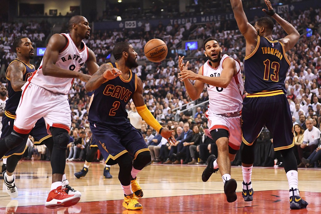 . Toronto Raptors guard Cory Joseph (6) loses the ball as he bumps into Cleveland Cavaliers centre Tristan Thompson (13) as Raptors forward Serge Ibaka (9) and Cavaliers guard Kyrie Irving (2) look on during the first half of Game 3 of an NBA basketball second-round playoff series in Toronto on Friday, May 5, 2017. (Frank Gunn/The Canadian Press via AP)