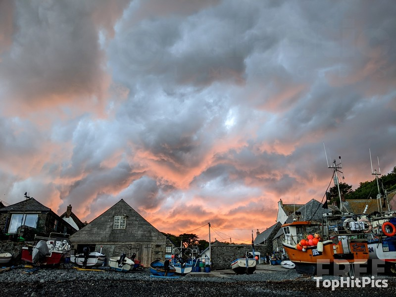 Sunset over the Fishing Boats in Cadgwith Cove, Cornwall, England