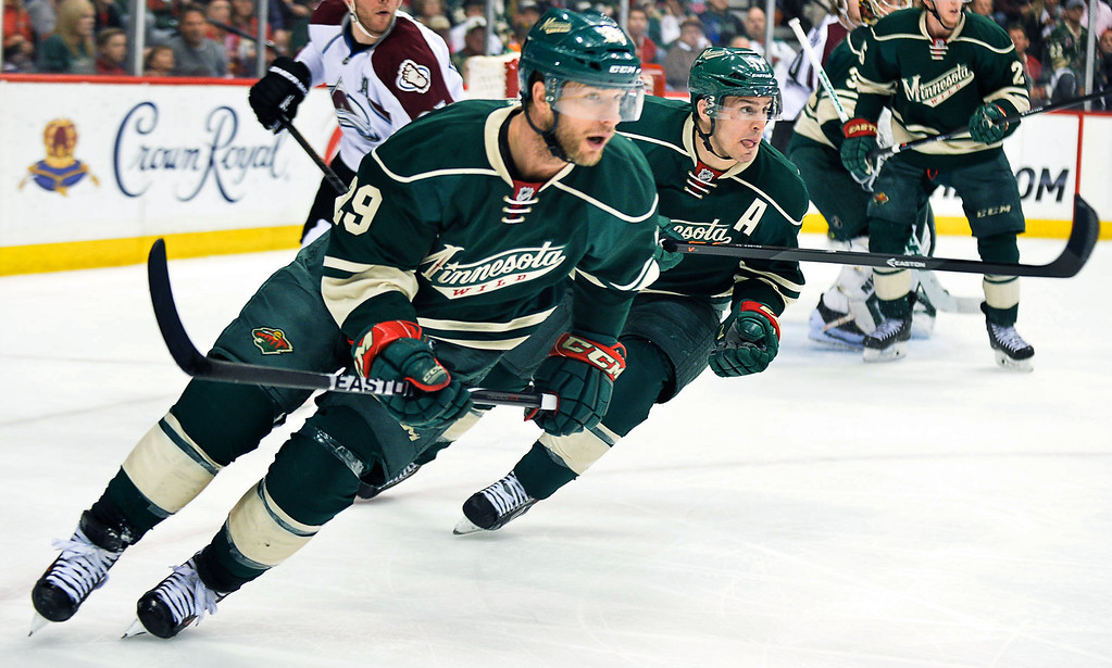 . The Wild\'s Jason Pominville, left, and Zach Parise head up the ice in the first period. (Pioneer Press: Ben Garvin)