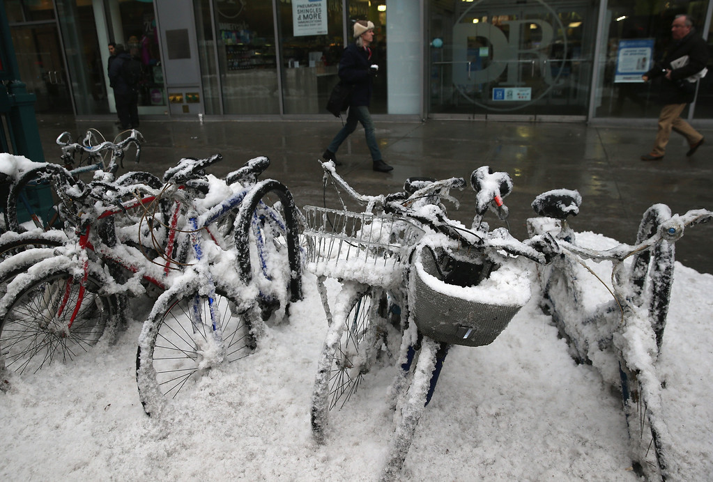 . Bikes sit covered in snow near Union Square on February 5, 2014 in New York City, United States. New Yorkers, like millions of Americans in the northeast, dealt with the latest winter storm, which dumped 4 inches of snow on Central Park before turning to rain.  (Photo by John Moore/Getty Images)