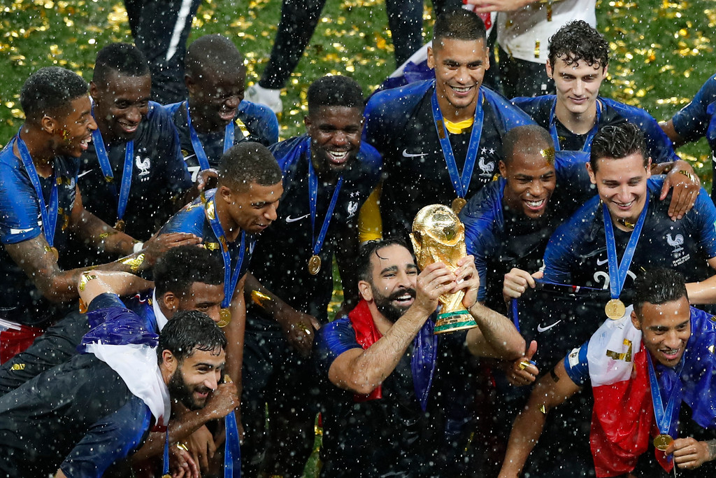 . France players celebrate with the trophy at the end of the final match between France and Croatia at the 2018 soccer World Cup in the Luzhniki Stadium in Moscow, Russia, Sunday, July 15, 2018. (AP Photo/Rebecca Blackwell)