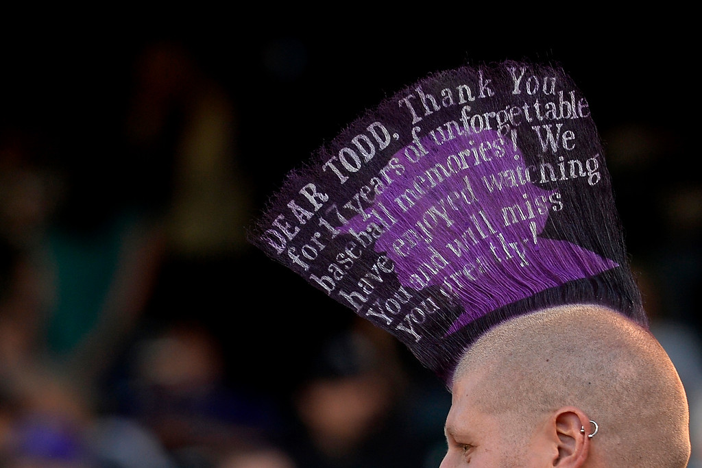 . A fan wears a mohawk paying homage to Todd Helton before the start of action in Denver. The Colorado Rockies hosted the Boston Red Sox and said farewell to longtime first baseman Todd Helton, who recently announced his retirement following this season. (Photo by John Leyba/The Denver Post)