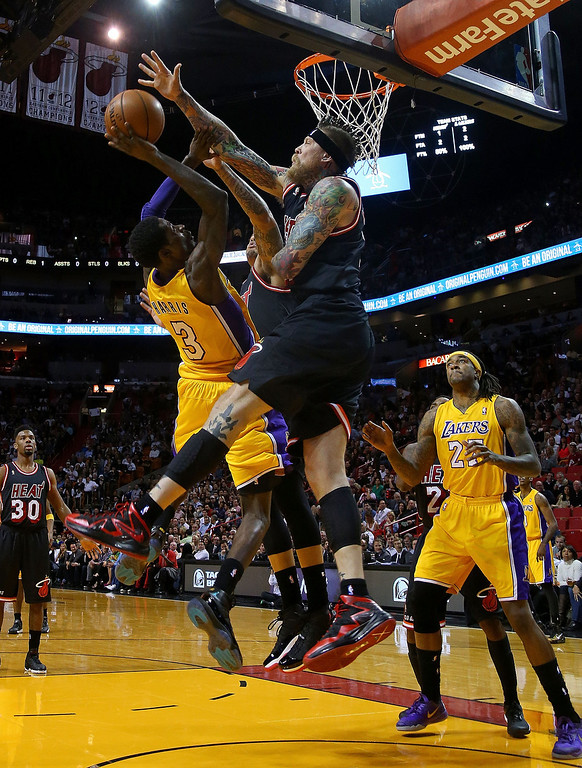 . Chris Andersen #11 of the Miami Heat blocks a shot from Manny Harris #3 of the Los Angeles Lakers during a game  at American Airlines Arena on January 23, 2014 in Miami, Florida.  (Photo by Mike Ehrmann/Getty Images)