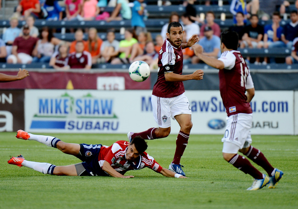 . Pablo Mastroeni of Colorado Rapids (25) steals the ball from Carlos Alvarez of Chivas USA (20), bottom, by Martin Rivero of Colorado (10) in the 1st half of the game at Dick\'s Sporting Goods Park. Commerce City, Colorado. May 25, 2013. (Photo By Hyoung Chang/The Denver Post)