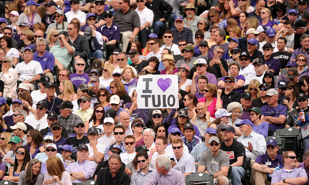 . A fan holds a sign for Troy Tulowitzki (2) of the Colorado Rockies. (Photo by Karl Gehring/The Denver Post)