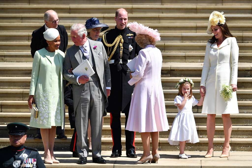 . From left, Doria Ragland, Britain\'s Prince Charles, Prince William, Camilla, Duchess of Cornwall, Princess Charlotte and Kate, Duchess of Cambridge leave after their wedding ceremony at St. George\'s Chapel in Windsor Castle in Windsor, near London, England, Saturday, May 19, 2018. (Ben Stansall/pool photo via AP)