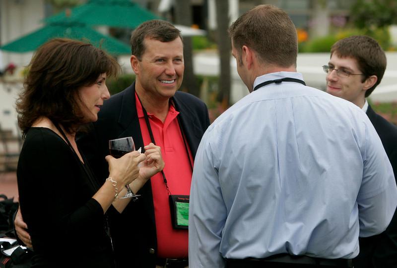 Teresa Perdue, Lanier Davenport, and Marchant Davenport (far right), with the FiReStarter company EcoVerdance, talk to FiRe event staffer Brent Morris