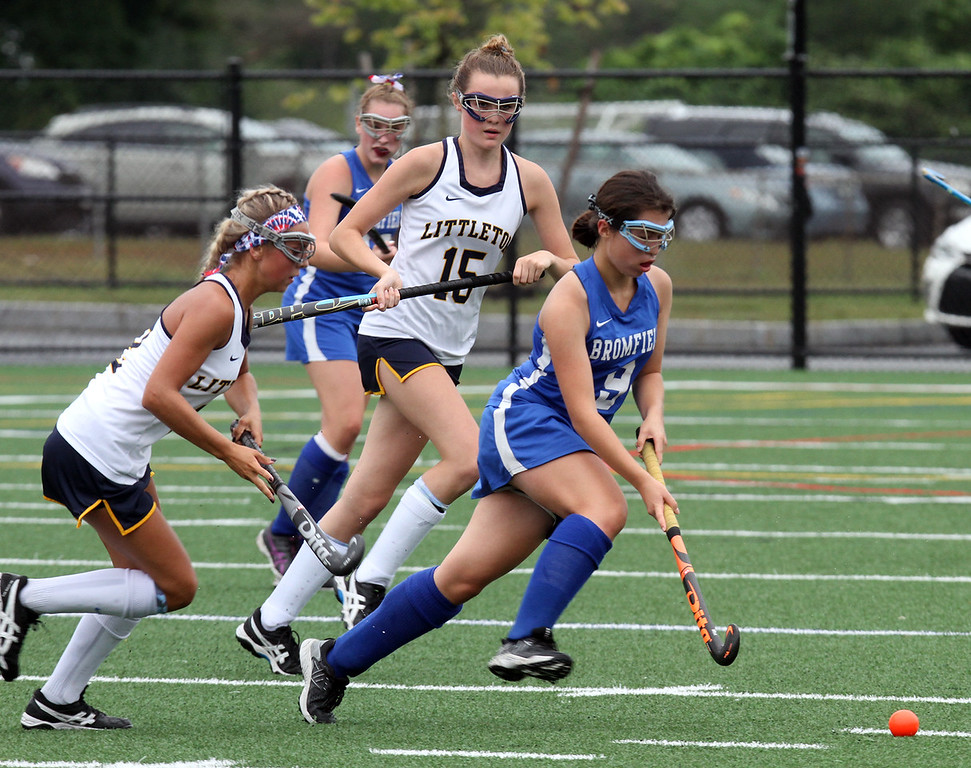 . Littleton vs Bromfield field hockey. Littleton\'s Molly Magnette (2) and Emma Beers (15), and Bromfield\'s Jordan Hoover (9). (SUN/Julia Malakie)