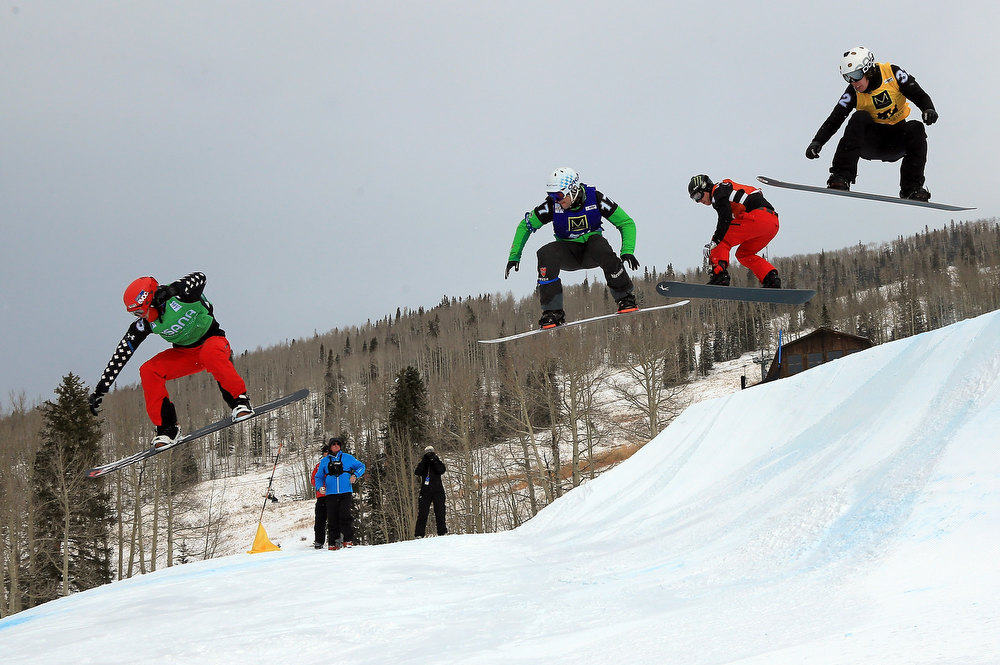 . (L-R) Christopher Robanske of Canada, Konstantin Schad of Germany, Nate Holland of the USA and Anton Lindfors of Finland compete in the first leg of their quarter final in the USANA Snowboardcross World Cup Team Event on December 15, 2012 in Telluride, Colorado. Holland and teammate Seth Wescott went on to finish first overall.  (Photo by Doug Pensinger/Getty Images)