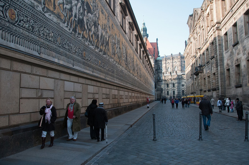Locals walking along street next to The Fürstenzug in Dresden, Germany