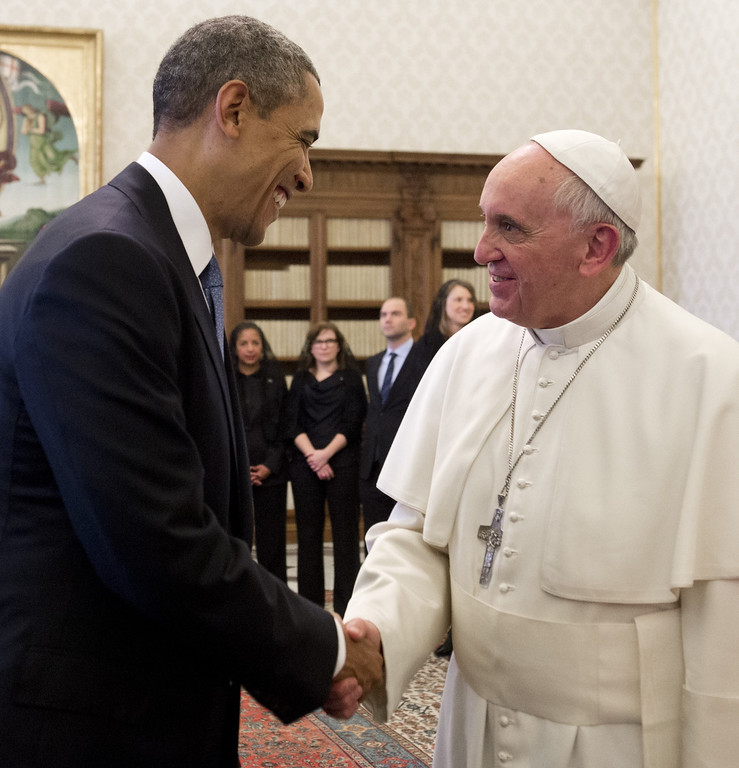 . Pope Francis (R) and US President Barack Obama shake hands after exchanging gifts during a private audience on March 27, 2014 at the Vatican. The meeting at the Vatican comes as a welcome rest-stop for Obama during a six-day European tour dominated by the crisis over Crimea, and the US leader will doubtless be hoping some of the pope\'s overwhelming popularity will rub off on him.    AFP PHOTO / SAUL LOEB/AFP/Getty Images